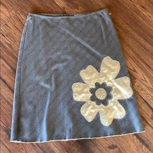 Gray skirt with flower accent.